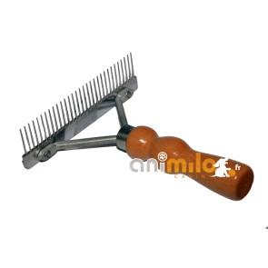 Etrille ou râteau avec poignée en bois, pour retirer les poils de chiens en mue, envers